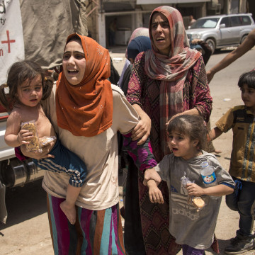 Image: Iraqi women and children fleeing the last fighters of ISIS in Mosul on Saturday.