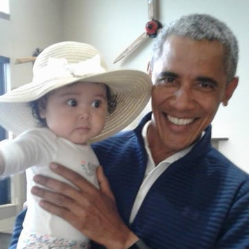 Image: Former U.S. President Barack Obama holds Giselle Jackinsky at Anchorage International Airport in Alaska