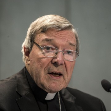 """Image: Cardinal George Pell tells reporters the allegations are """"false."""""""