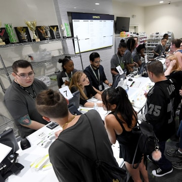Image: Customers buy cannabis products at Essence Vegas Cannabis Dispensary