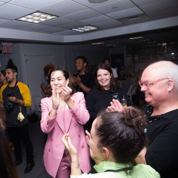 Mexican clothing designer Barbara Sanchez-Kane applauds her models, makeup team and stylists after her New York Fashion Week Men's show on July 12, 2017.