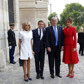 Image: French President Emmanuel Macron and his wife Brigitte  pose with President Donald Trump and First Lady Melania Trump
