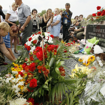 Image: Local residents lay flowers to commemorate victims of the Malaysian Airlines plane, near the village of Hrabove, Donetsk region, eastern Ukraine, July 17, 2017.