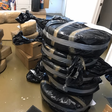 Image: Packed marijuana seized from Ford Fusion vehicles