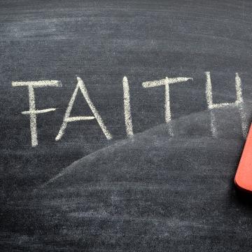 erasing faith, hand written word on blackboard being erased concept