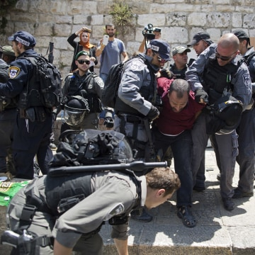Image: Israeli police officers detain a Palestinian man outside the Lion's Gate