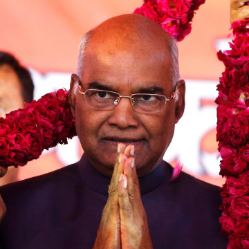Image: Ram Nath Kovind, India's new president, is presented with a garland as part of a nation-wide tour in Ahmedabad