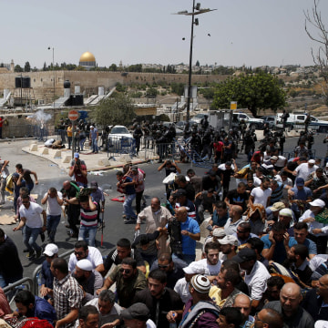 Image: Worshipers run from teargas fired by Israeli forces in Jerusalem