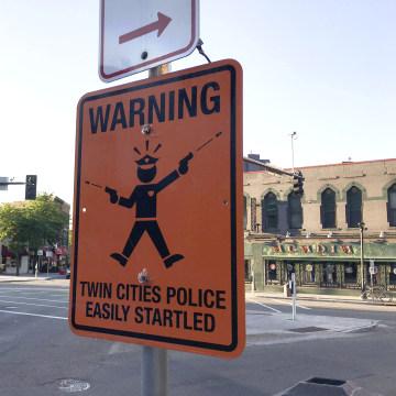 Image: Sign mocking Minneapolis police