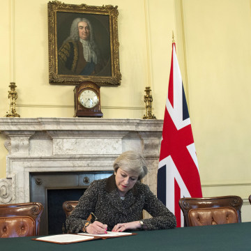 Image: British Prime Minister Theresa May signs a letter setting out the U.K.'s intention to withdraw from the EU