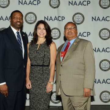 Image: Derrick Johnson, Interim President and CEO of the NAACP, from left, Belinda Johnson, Airbnb's Chief Business Affairs Officer and Leon Russell, Chair of the NAACP Board.