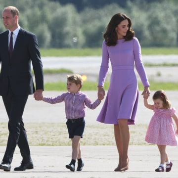 Image: Prince William and his wife Kate, the Duchess of Cambridge, and their children