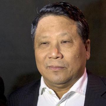 Image: Ng Lap Seng, a Macau billionaire real estate developer, exits the Manhattan U.S. District Courthouse in New York