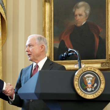 Image: President Trump congratulates new U.S.  Attorney General Sessions after being sworn in at the White House in Washington
