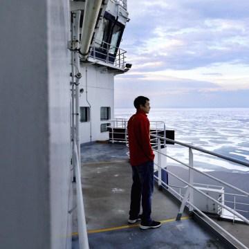 Image: David Kullualik looks over the sea ice of Peel Sound.