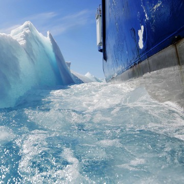 Image: Broken sea ice emerges from under the hull of the Finnish icebreaker MSV Nordica.
