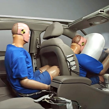Image: A sled test simulating 35 mph frontal crash with the back seat passenger without a belt.
