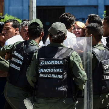 Image: Venezuela's chief prosecutor Luisa Ortega (C), one of President Nicolas Maduro's most vocal critics, is surrounded by people and national guards during a flash visit to the Public Prosecutor's office in Caracas on Aug. 5, 2017.