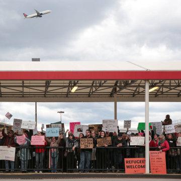Image: Demonstrators yell slogans during anti-Donald Trump travel ban protests outside Hartsfield-Jackson Atlanta International Airport in Atlanta