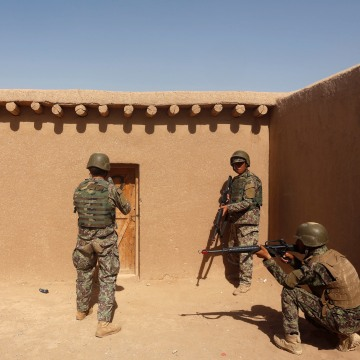 Image: A U.S. Marine, left, watches Afghan National Army (ANA) soldiers during training in Helmand province