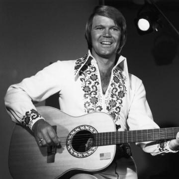Image: Singer Glen Campbell plays guitar