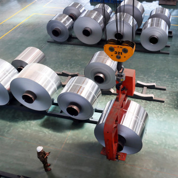 Image: An Employee Looks at an Aluminium Foil Roll Being Lifted at a Plant in Binzhou