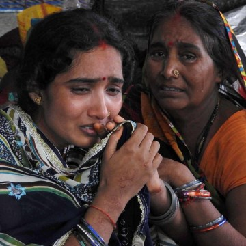 Image: Relatives mourn the death of a child