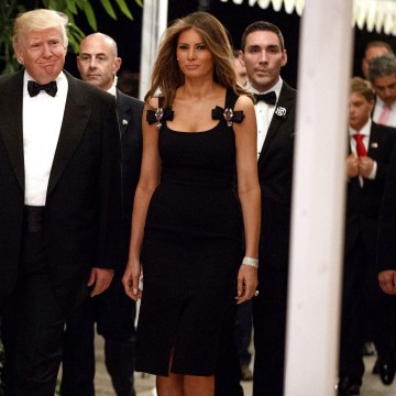 Image: This Dec. 31, 2016 file photo shows President-elect Donald Trump and his wife Melania Trump arriving for a New Year's Eve party at Mar-a-Lago in Palm Beach, Florida.