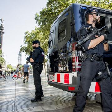 Image: Police are deployed to guard an area located at the end of Las Ramblas following a terrorist attack on Aug. 17.
