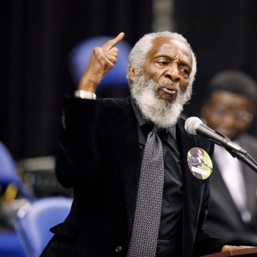 Image: Dick Gregory speaks at the 2011 funeral for singer James Brown.