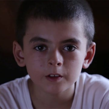 "Image: A child who indicated that his name is Yousef, 10, speaks in an ISIS video titled ""The Fertile Nation, part 4."""