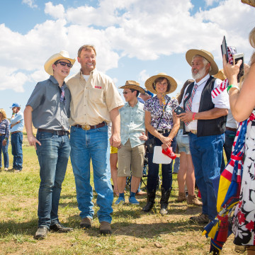 Image: Dean Heller, center right, poses for pictures