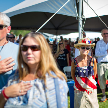 Image: Clare Price, center, of Incline Village, Nevada, looks on during the national anthem