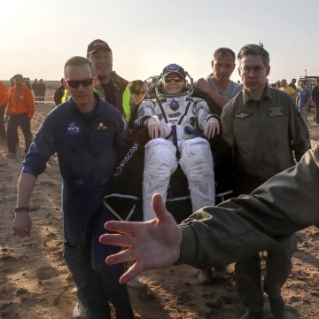 Image: Ground personnel carry U.S. astronaut Peggy Whitson after landing in a remote area outside the town of Jezkazgan, Kazakhstan, Sept. 3, 2017.