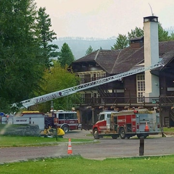 Image: A fire truck is positioned outside Lake McDonald Lodge