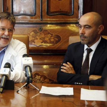 "Image: Tropical diseases expert Alberto Matteelli, left, is flanked by Ezio Belleri, general manager of the ""Spedali Civili"" hospital"