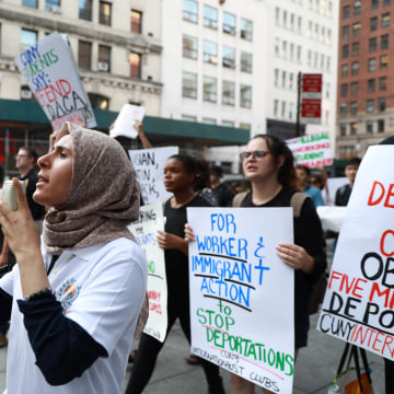 Image: Protesters march around City Hall to protest the planned dissolution of DACA in Manhattan, New York City