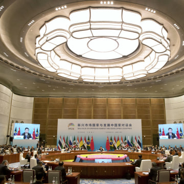 Image: Leaders attend the Dialogue of Emerging Market and Developing Countries