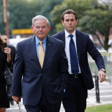 Image: Senator Bob Menendez arrives to face trial for federal corruption charges with his children Alicia Menendez and Robert Melendez Jr. at United States District Court for the District of New Jersey in Newark