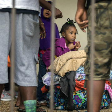 Image: An unidentified little girl waits with her family at the Savannah Civic Center to evacuate from he path of Hurricane Irma, Sept., 9, 2017 in Savannah, Georgia.