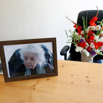 Image: A photo of Nancy Hatch Dupree and flowers at her office in Kabul after she passed away.