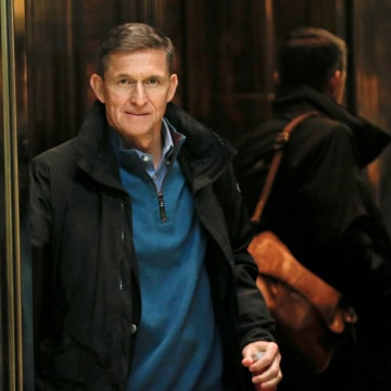 Image: Retired U.S. Army Lieutenant General Michael Flynn boards an elevator as he arrives at Trump Tower where U.S. President-elect Donald Trump lives in New York