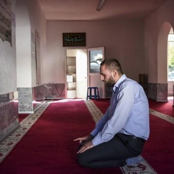 Image: Albert Berisha prays in Ferizaj