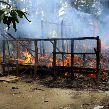 Image: A house on fire in the north of Rakhine, Myanmar