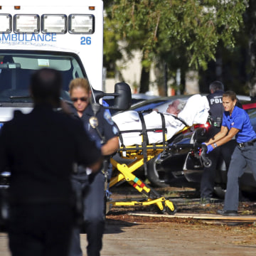 Image: A woman is transported from The Rehabilitation Center at Hollywood Hills