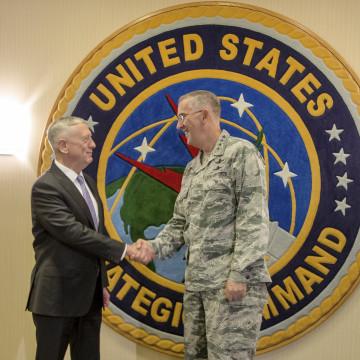 Image: Mattis poses for a handshake at Offutt Air Force Base with Gen. John E. Hyten, the head of Strategic Command, in Bellevue, Nebraska