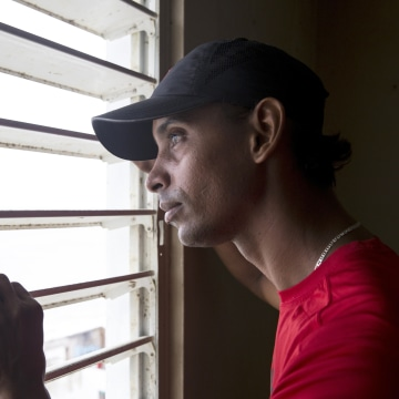 Image: Geraldo Ramirez, 36, in his home on Calle San Miguel in the La Perla neighborhood the day after Hurricane Maria made landfall on Sept. 21, 2017 in San Juan, Puerto Rico.