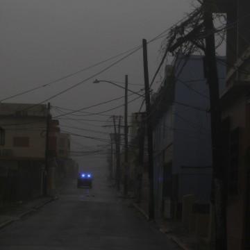 Image: A police car patrols a road as Hurricane Maria hits Puerto Rico in Fajardo