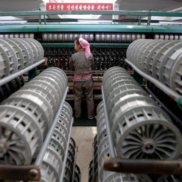Image: FILE PHOTO - A woman works at the Kim Jong Suk Pyongyang textile mill during a government organised visit for foreign reporters in Pyongyang