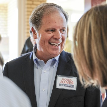 Image: Candidate Doug Jones chats with constituents